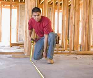 Worker measuring quantities
