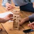 People playing Jenga