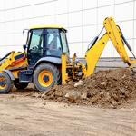 Excavator digging hole