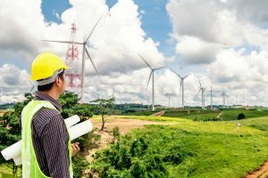 project engineer looking at windmills